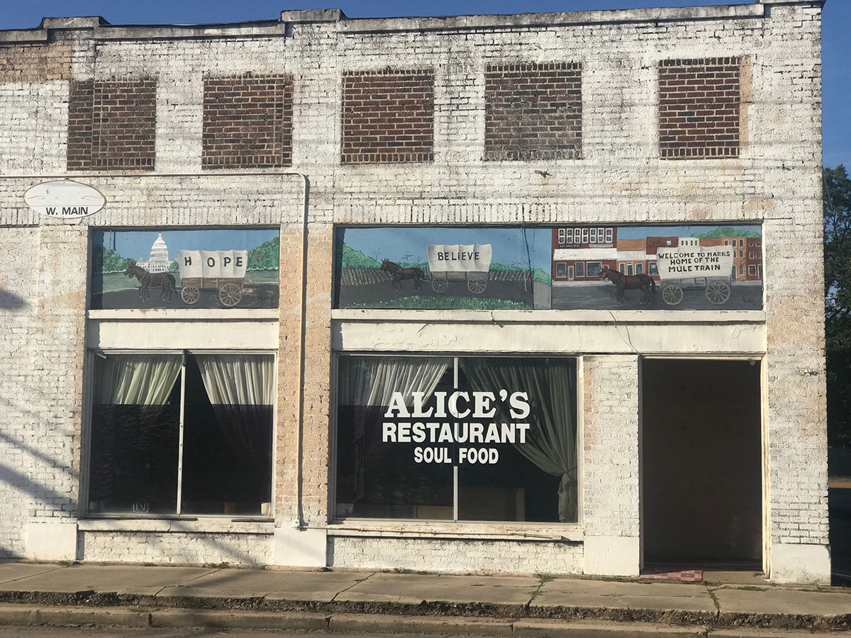 Exterior of Alice's Restaurant with Mule Train mural, Main Street, Marks, Mississippi.
